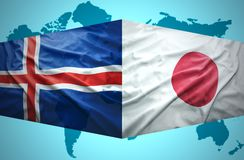Waving Icelandic and Japanese flags Royalty Free Stock Photos