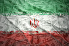 Waving iranian flag on a american dollar money background Stock Photo