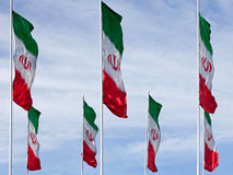 Waving Iranian Flags against Cloudy Blue Sky Stock Photo