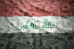 Waving iraqi flag on a american dollar money background Stock Photography