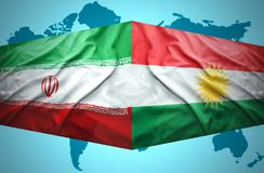 Waving Kurdish and Iranian flags. Of the political map of the world Stock Photo