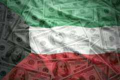 Waving kuwait flag on a american dollar money background Stock Image