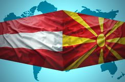 Waving Macedonian and Austrian flags. Of the political map of the world Royalty Free Stock Photos