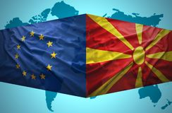 Waving Macedonian and European Union flags Stock Images