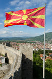 Waving macedonian flag on Samuel fortress. Walls and towers of Samuel's fortress with waving macedonian flag, Ohrid, Macedonia Royalty Free Stock Image