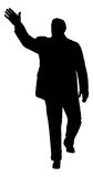 Waving Man. A silhouette of a man in a suit waving Royalty Free Stock Images