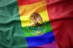 Waving mexico rainbow gay pride flag banner. Waving colorful mexico rainbow gay pride flag banner stock image