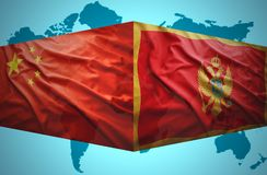 Waving Montenegrin and Chinese flags Royalty Free Stock Images