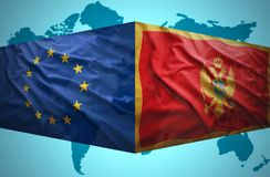 Waving Montenegrin and European Union flags Royalty Free Stock Photo
