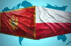 Waving Montenegrin and Polish flags Stock Photos