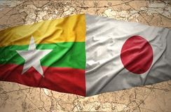 Myanmar and Japan. Waving Myanmar and Japanese flags of the political map of the world Stock Photos
