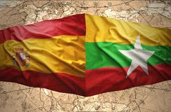 Myanmar and Spain. Waving Myanmar and Spanish flags of the political map of the world Stock Images