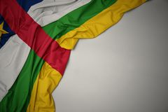 Waving national flag of central african republic on a gray background. Waving colorful national flag of central african republic on a gray background royalty free stock images