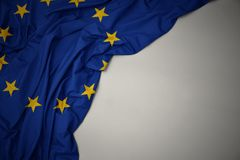 Waving national flag of european union on a gray background. Waving colorful national flag of european union on a gray background stock photography