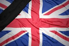 National flag of great britain with black mourning ribbon. Waving national flag of great britain with black mourning ribbon Stock Image