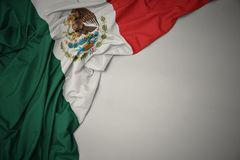 Waving national flag of mexico on a gray background. Waving colorful national flag of mexico on a gray background royalty free stock photo