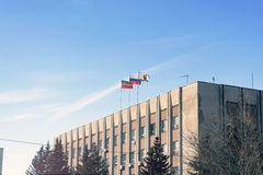 Waving national flag of russian federation on top building against bright blue sky Royalty Free Stock Photography