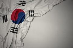 Waving national flag of south korea on a gray background. Waving colorful national flag of south korea on a gray background stock images