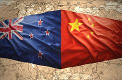 New Zealand and China. Waving New Zealand and Chinese flags of the political map of the world Stock Image