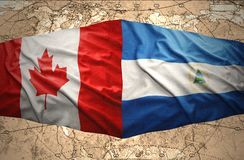 Nicaragua and Canada. Waving Nicaraguan and Canadian flags on the of the political map of the world Stock Images
