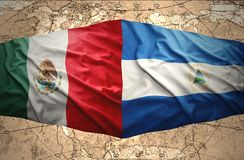 Nicaragua and Mexico. Waving Nicaraguan and Mexican flags on the of the political map of the world Royalty Free Stock Photos