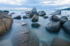 Waving over stone in a beach Stock Image