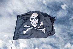Waving pirate flag jolly roger Stock Images