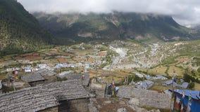 Waving prayer flags in Upper Pisang - Nepal stock video