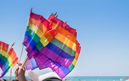 Waving rainbow flags with David Star for sale. At annual gay pride parade & festival in Tel-Aviv stock photography