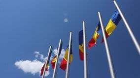 Waving romanian flags. And clouds on sky