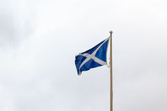 Waving Scotland flag. A waving scotland flag on a pole in Fort George, Scotland stock image
