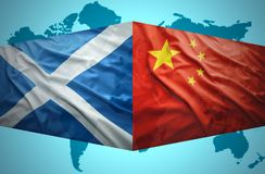 Waving Scottish and Chinese flags. Of the political map of the world Stock Photography