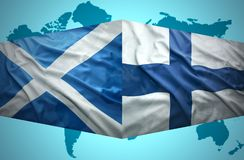 Waving Scottish and Finnish flags. Of the political map of the world Royalty Free Stock Photos