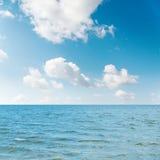 Waving sea and cloudy sky with sun Stock Photo