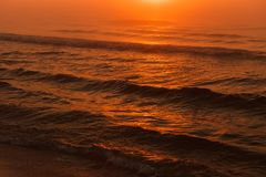 Waving sea during sunset Royalty Free Stock Photos