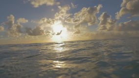 Waving sea water and sunset in cloudy sky stock video