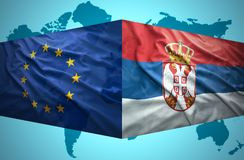 Waving Serbian and European Union flags Stock Images