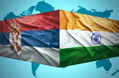 Waving Serbian and Indian flags. Of the political map of the world royalty free stock images