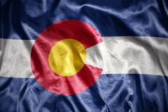 Shining colorado state flag. Waving and shining colorado state flag royalty free stock images