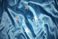 Shining federated states of micronesia flag. Waving and shining federated states of micronesia flag Stock Photo