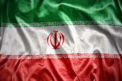 Shining iranian flag. Waving and shining iranian flag Royalty Free Stock Photos