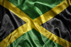Shining jamaican flag. Waving and shining jamaican flag stock image