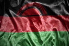 Shining malawi flag. Waving and shining malawi flag Stock Photos