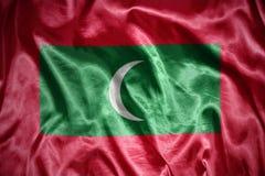 Shining maldives flag. Waving and shining maldives flag Royalty Free Stock Images