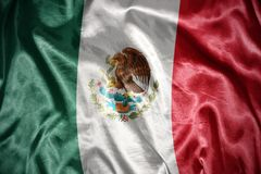 Shining mexican flag. Waving and shining mexican flag royalty free stock photo
