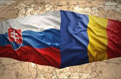 Slovakia and Romania. Waving Slovak and Romanian flags of the political map of the world Stock Photo