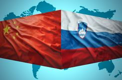 Waving Slovenian and Chinese flags Stock Photography