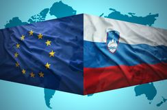 Waving Slovenian and European Union flags Royalty Free Stock Photos