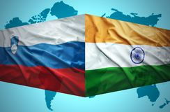 Waving Slovenian and Indian flags Stock Photo