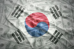 Waving south korea flag on a american dollar money background Stock Photography